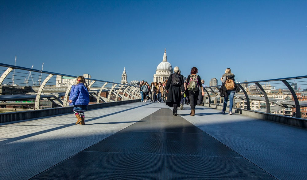 lookinf across millennium bridge to st pauls cathedral in london