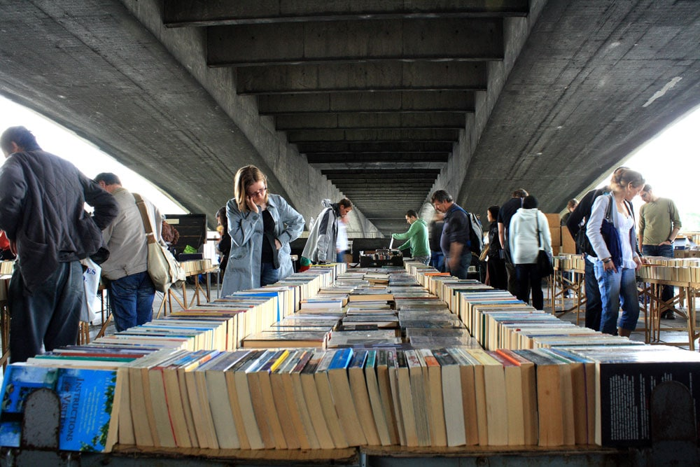 people browsing open air book stall