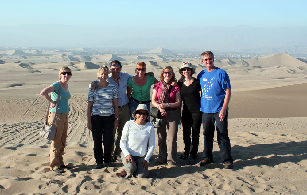 a group of travellers by a desert in peru