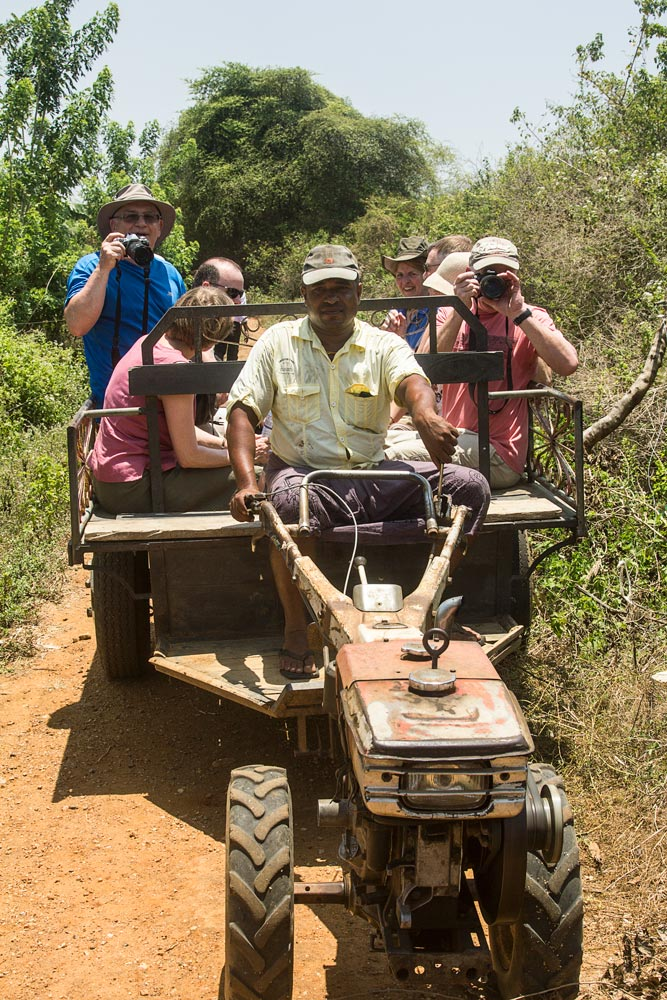 small group of people travelling on a tractor