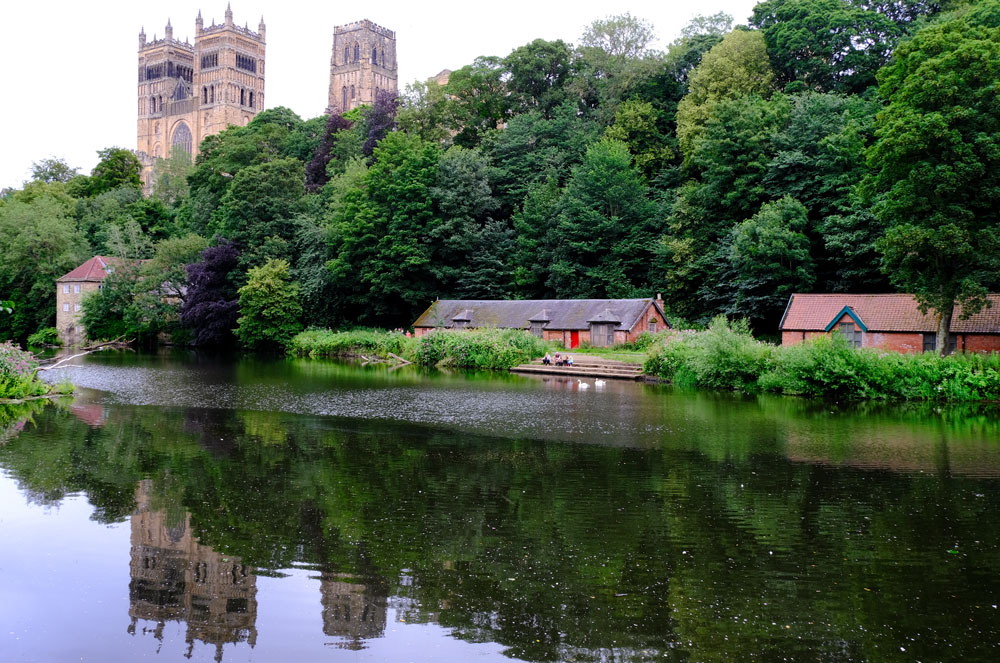 durham castle reflected in the water of river