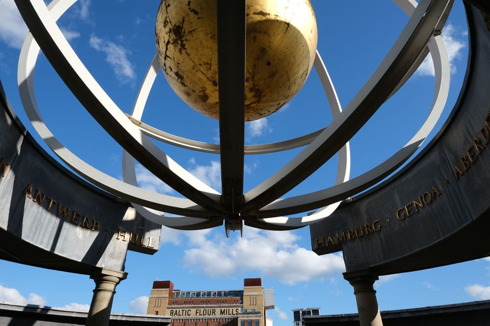 globe sculpture on newcastle quayside with baltic building in background