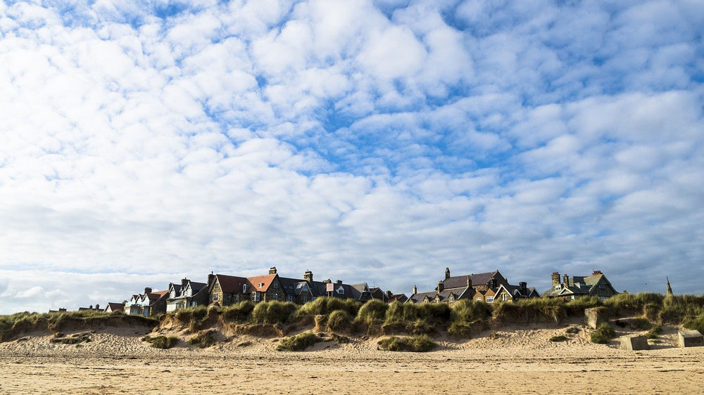 buildings of alnmouth from a distance