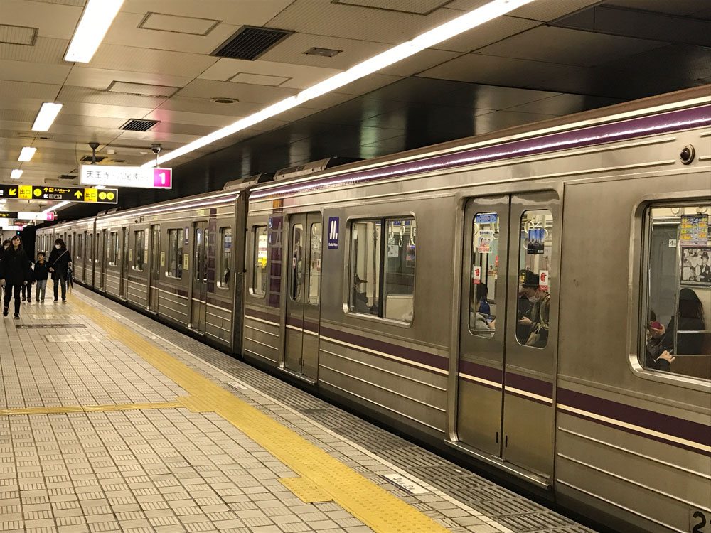 train on platform osaka subway