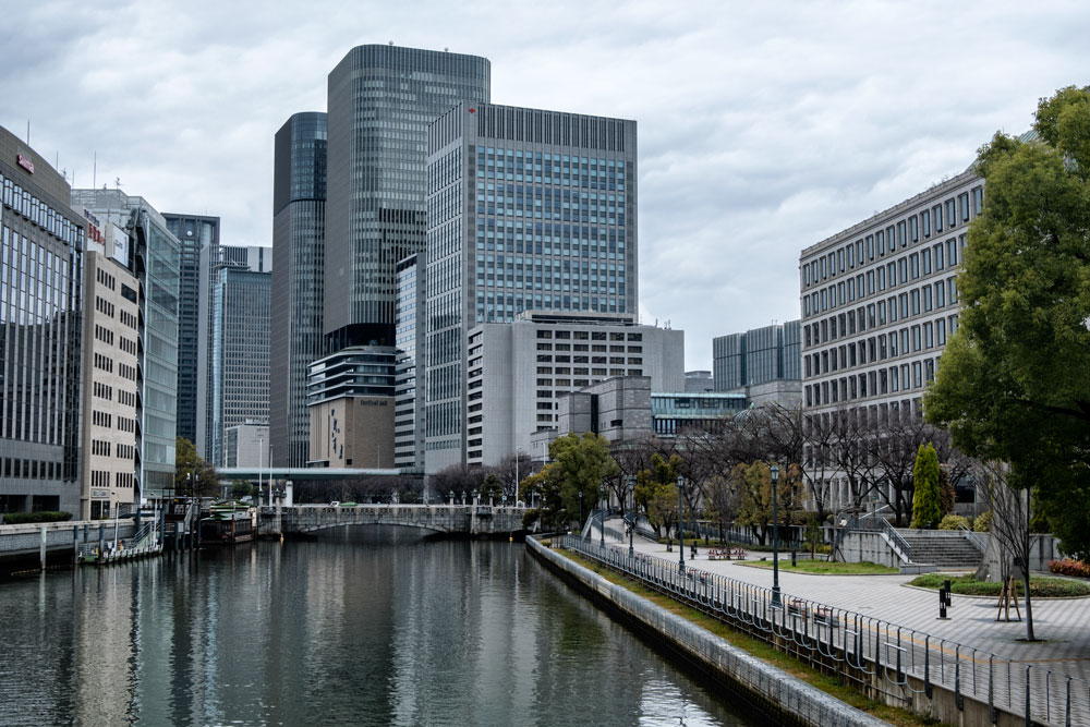 buildings lining river in osaka