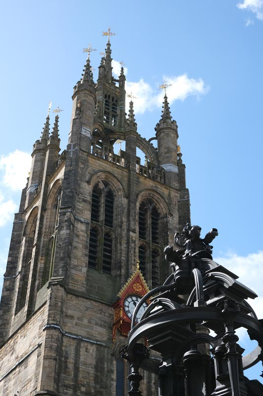 statue of queen victoria in front of newcastle cathedral