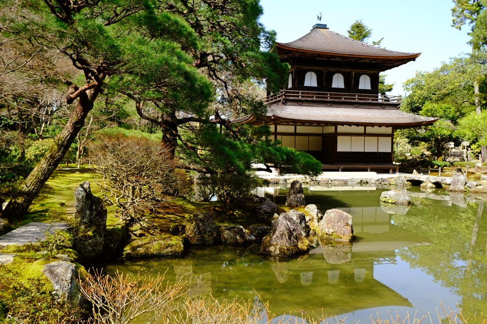 temple building of ginkaku-ji in kyoto with reflection in pond