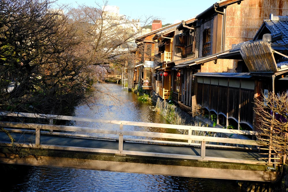 old wooden buildings with bridge and canal in gion district which is part of a 3-day kyoto itinerary