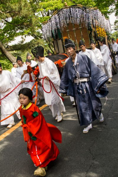 Japanese people in traditional costume with horse and cart during festival in kyoto
