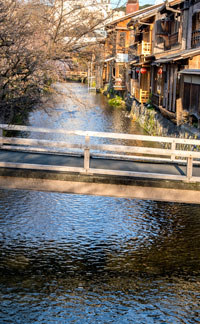 old wooden buildings with bridge and canal in gion district of kyoto