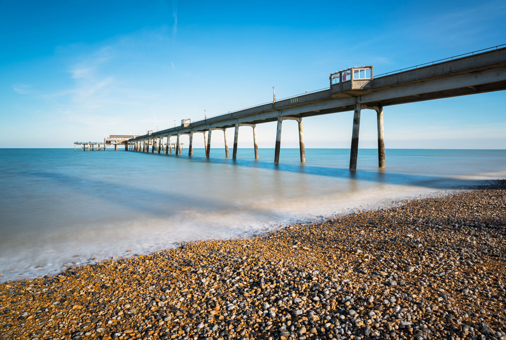pier-at-deal-kent-against-a-pebble-beach-and-blue-sky