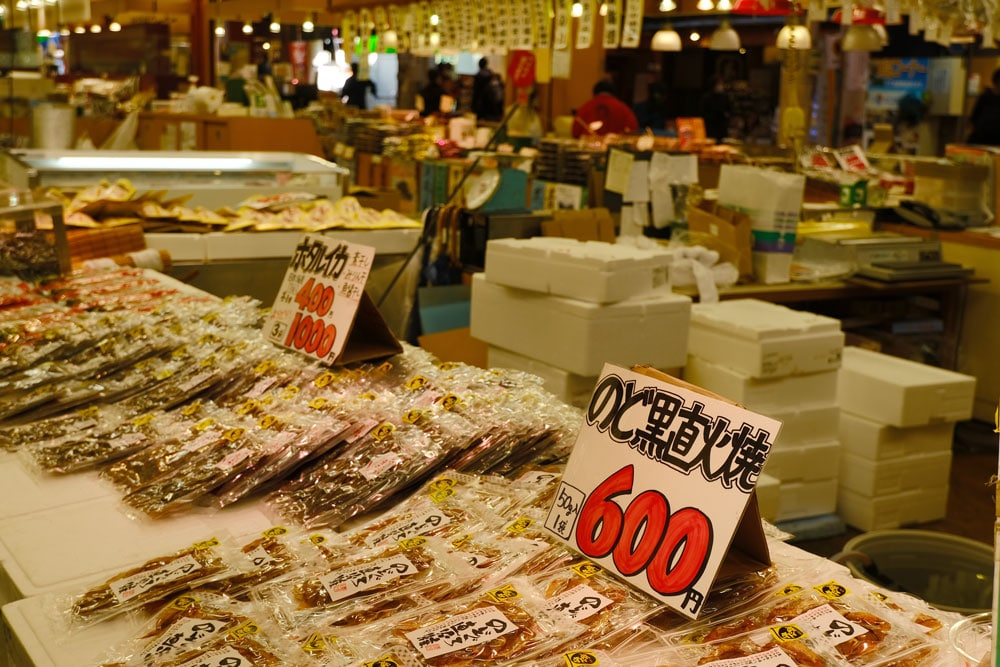dried fish for sale with japanese price signs at kanazawa-omicho-marke