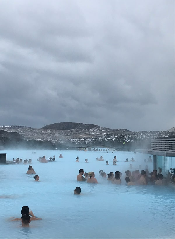 people in the water at blue lagoon iceland