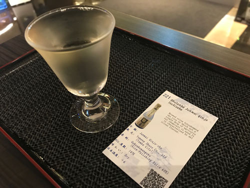 glass of sake with information card