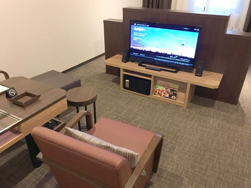 seating area in hotel room with tv
