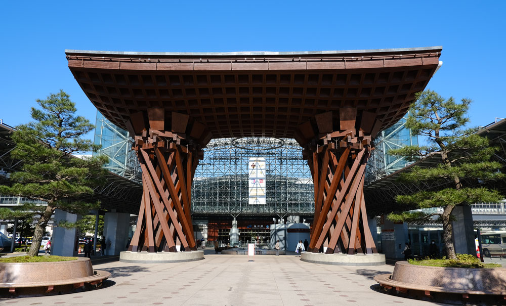 wooden tori structure in front of train station building in kanazawa japan