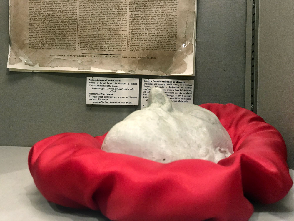 plaster death mask of robert emmett in red stain pillow