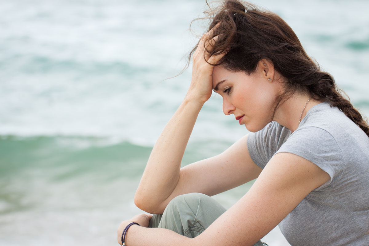 depressed woman deep in thought with post-travel blues