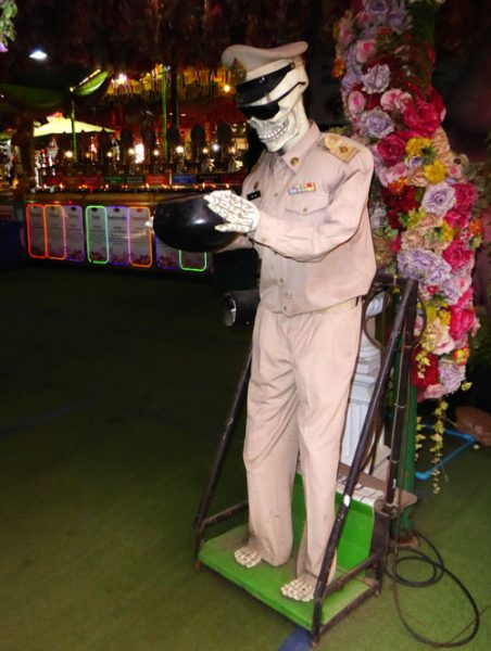 animatronic statue of skeleton in suit at ayutthaya temple