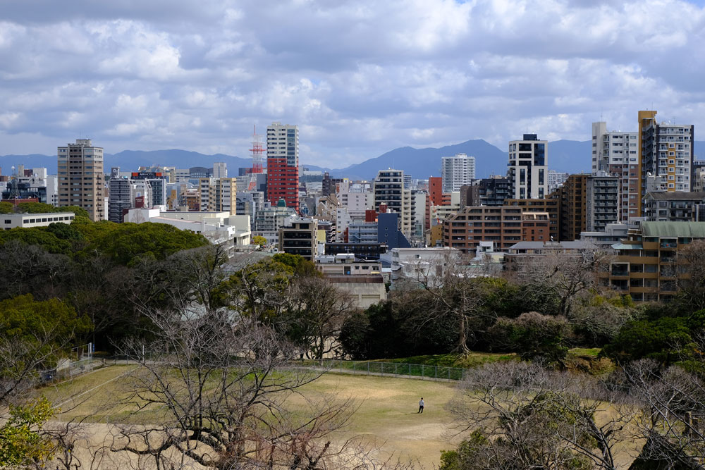 skyline of fukuoka japan with solitary person in foreground