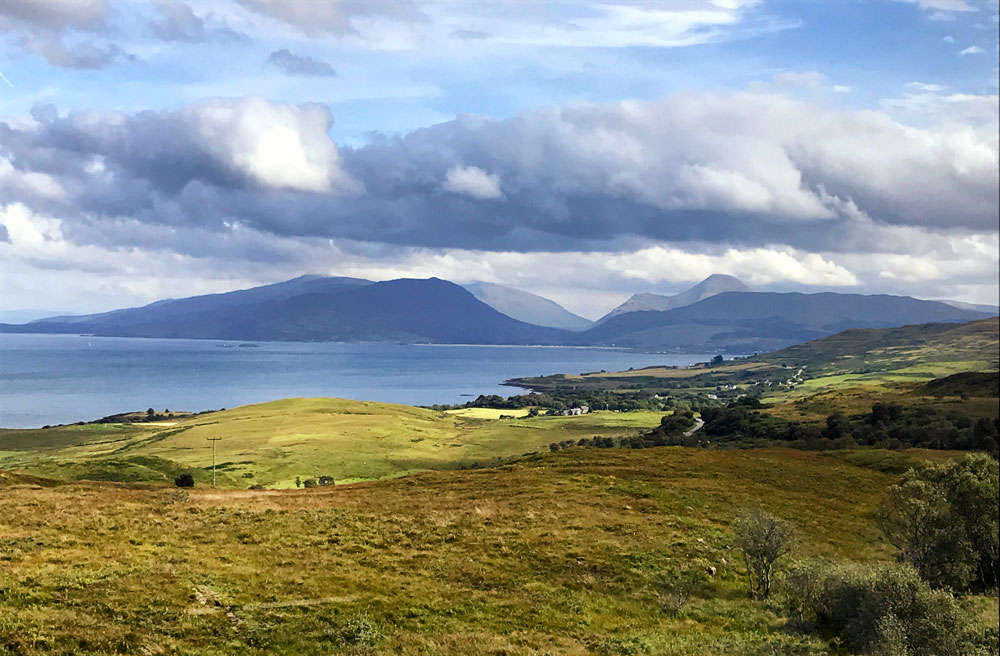 landscape of gentle hills and sea on mull scotland