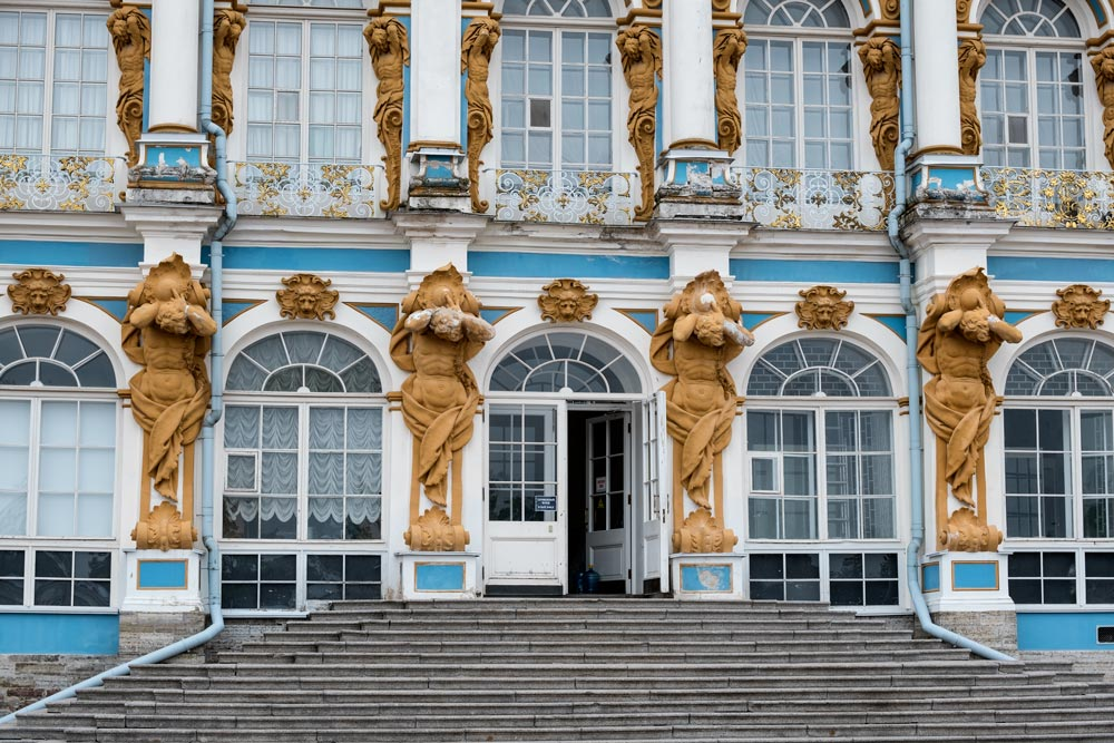 blue and white facade of catherine palace with four statues