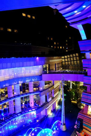 illuminated fountain in shopping centre atrium which is one of the best things to do in fukuoka japan