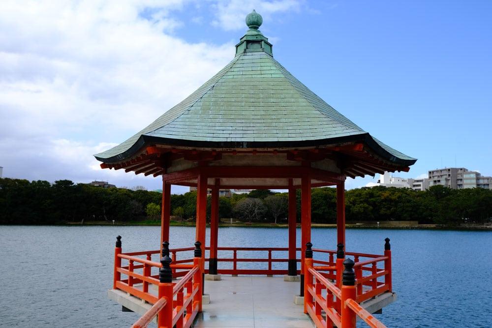 pagoda jutting out in the water at ohori park fukuoka