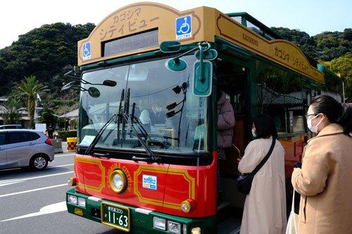 people boarding brightly coloured retro bus