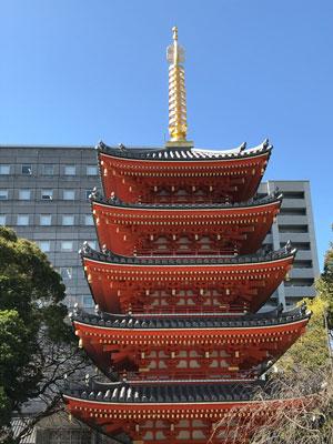 red and gold pagoda in fukuoka japan