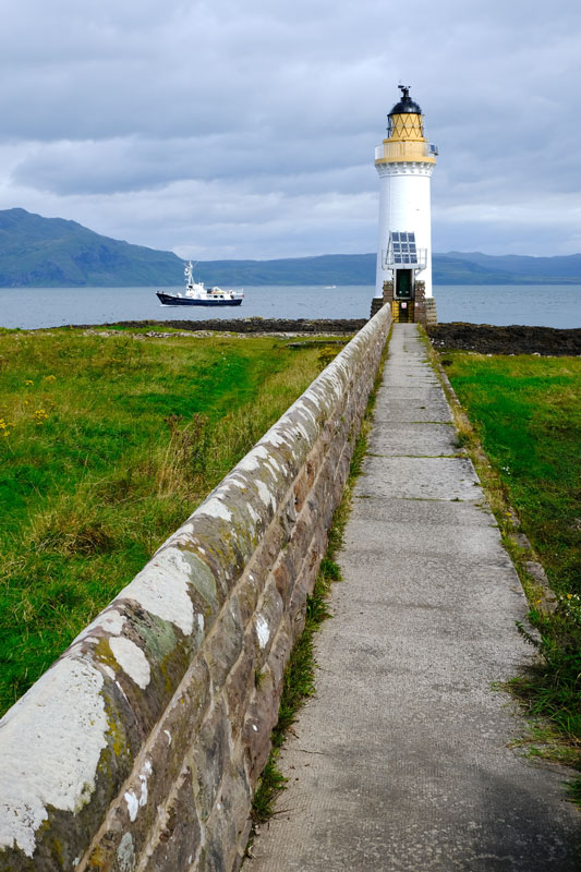 long path leading to a lighthouse on mull scotland