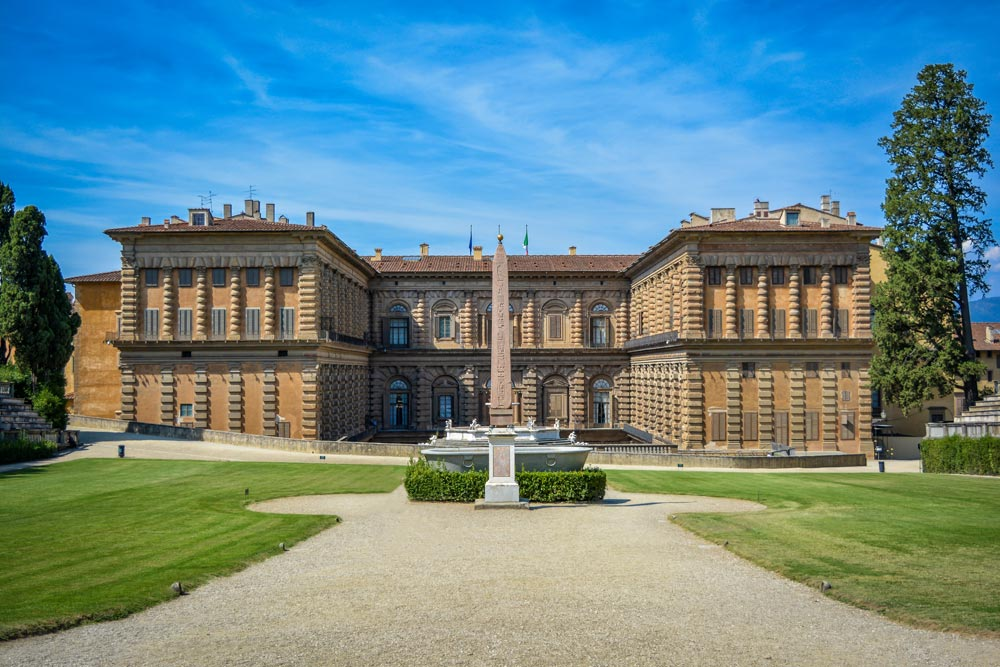colonnaded facade of pitti palace under blue sky