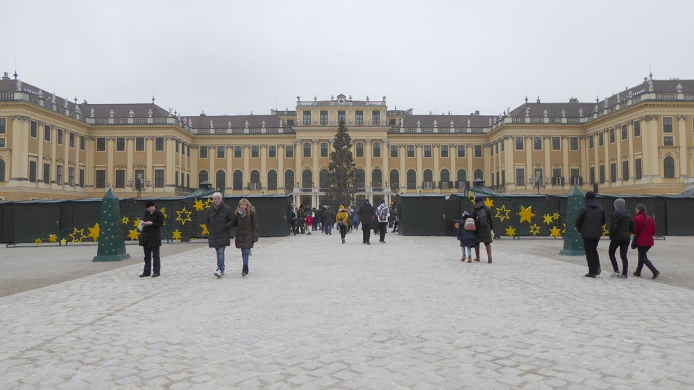 people walking in front of schonbrunn-palace-vienna