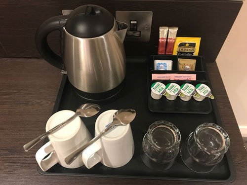 tray with mugs glasses kettle and tea and coffees sachets at premier inn heathrow 44