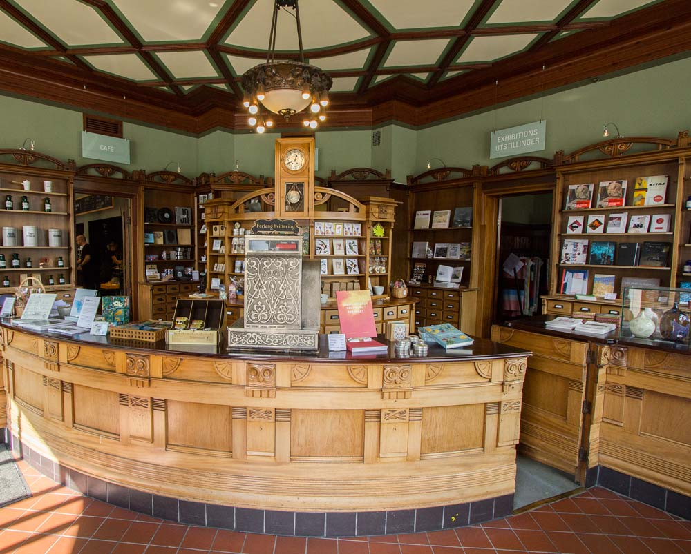interior of old chemist shop with wooden counter