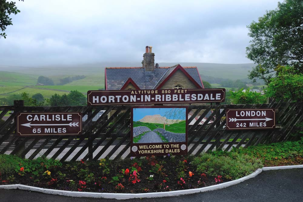 horton in ribblesdale railway station sign with station house