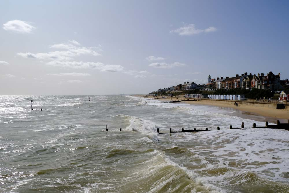 rolling surf beach and houses of southwold suffolf