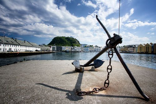 anchor in foreground of fishing harbour