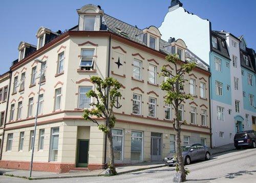 pastel colored art nouveau buildings in alesund norway