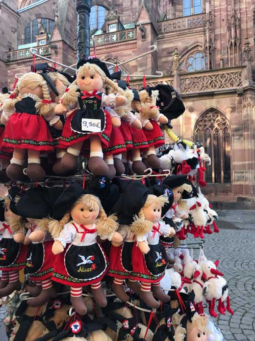 stuffed dolls hanging outside strasbourg cathedral