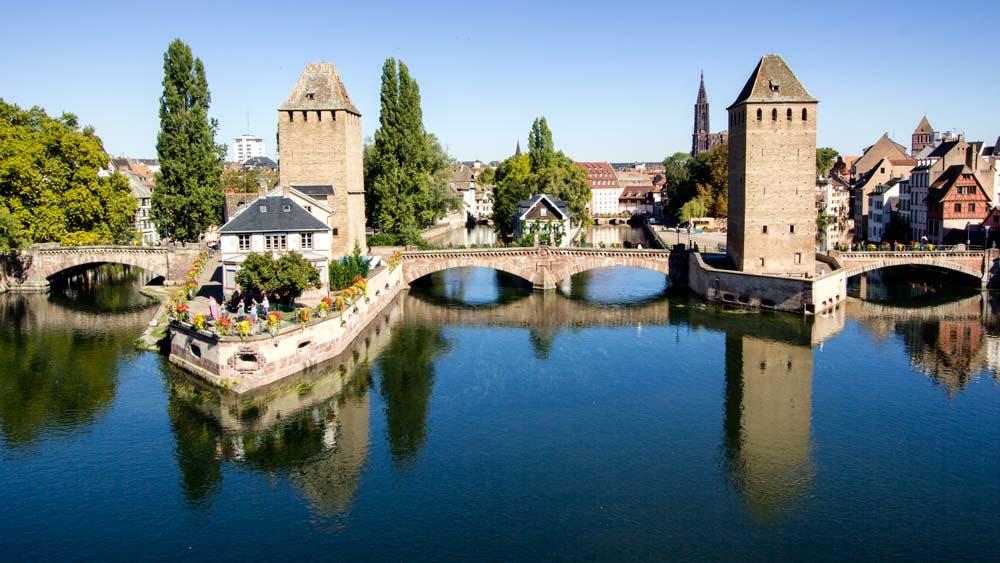 stone bridge reflected in water