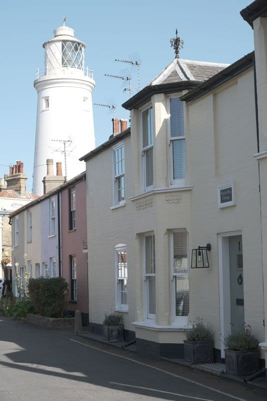 lighthouse-and-streets with pastel colored houses