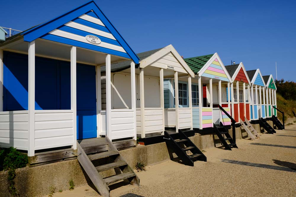 brightly coloured beach huts on southwold beach