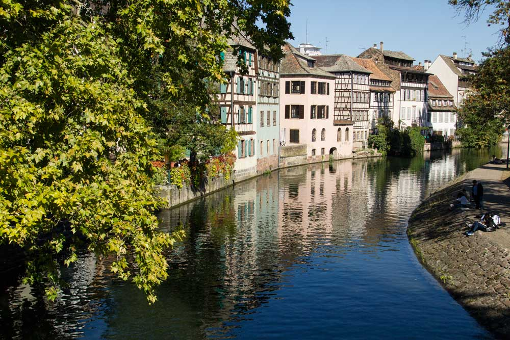 half timbered buildings reflected in canal in strasbourg france