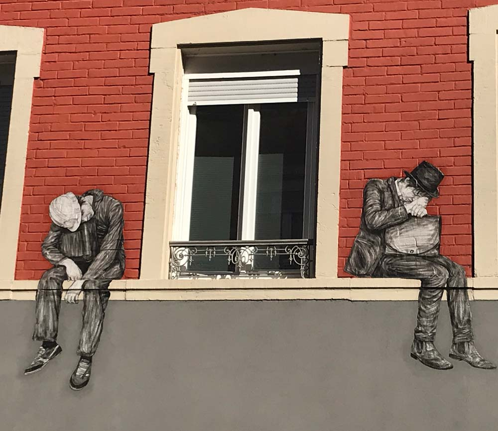 mural of two men on either side of a window