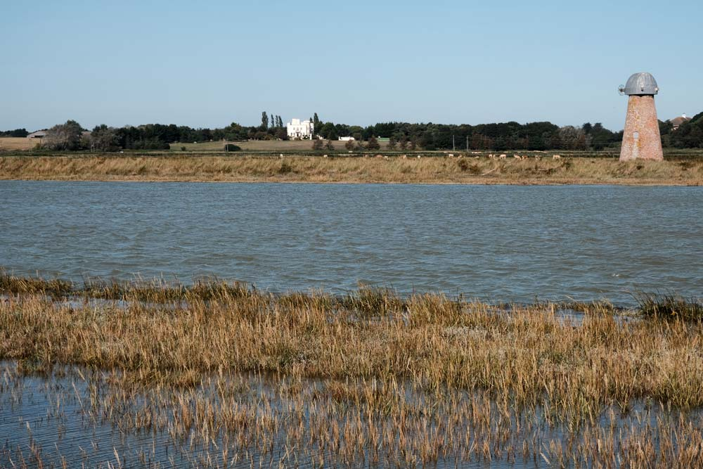 river and reed beds and disused windmill in walberswick suffolk