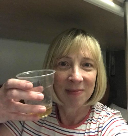 woman holding up glass of whisky