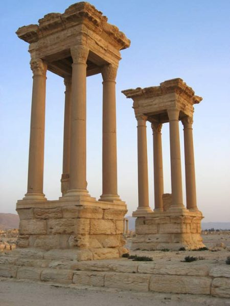 ancient corinthian columns in 2 groups of 4