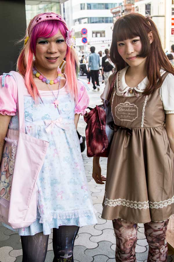 two women posing for a photo in tokyo
