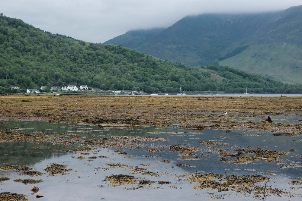 loch leven with houses and mountain in background which is one of the best things to see in glencoe
